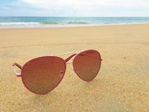 Sunglasses on the beach Stock Photos