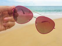 Sunglasses on the beach Stock Photography