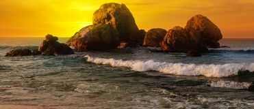 Sea landscape with rocky island and the sunrise. Wide photo. Sea landscape with rocky island and the sunrise. Beach. Sri Lanka. Wide photo Royalty Free Stock Photo