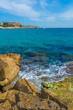 Sea Landscape from Salou , Coast of Spain. Water crashing into the rocks in the beach of Salou, Spain Stock Photo