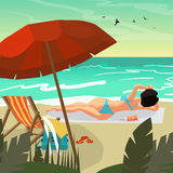 Sea landscape summer beach. Young woman in bikini sunbathing Stock Photo