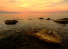Sea landscape at sunset. A sea landscape at sunset, with warm tonalities. It evokes quietness and beauty Royalty Free Stock Images
