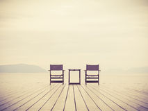 Sea Landscape with two chairs Love concept background. Sea and mountain Landscape with two chairs Love concept background Royalty Free Stock Photo