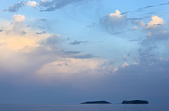 Sea landscape with two islands and beautiful sky Stock Images
