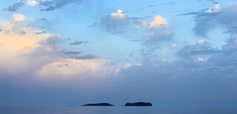 Sea landscape with two islands and beautiful sky Stock Photo