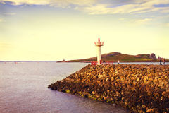 Beautiful scenic sea landscape. Sea Landscape. View on Howth Harbour Lighthouse, Howth Peninsula, county Dublin, Ireland. Lightly toned Royalty Free Stock Photos