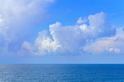Sea landscape with waves and sky with clouds in summer. A puffy white, cloudy sky over the sea during a bright day Royalty Free Stock Photos