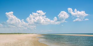 Sea landscape white curly clouds and blue sea shore, Stock Photos