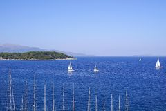 Sea landscape with yachts and a massif on the horizon Royalty Free Stock Images