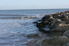 Sea lapping on pebbles and stones Royalty Free Stock Photography
