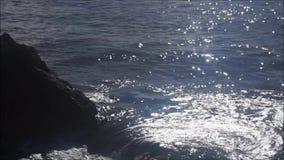 Sea Lapping on Rocks stock footage