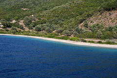 Sea of Lefkada, Meganissi, Greece. Sea of Lefkada, Greece. Meganissi Beach, the largest of the islands of Lefkada. A thin line of sand divides the green of the Stock Photo
