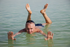 Sea Leisure. A man bathing in the Dead Sea Stock Photography