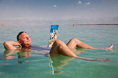 Sea Leisure. A man bathing in the Dead Sea Royalty Free Stock Photography
