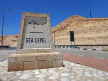 Sea Level. Marker on road to Jericho, an ancient town on the West Bank stock images