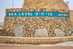 Sea level sign approaching Dead Sea, Israel. Sea level sign written in 3 languages approaching Dead Sea, Israel royalty free stock photo