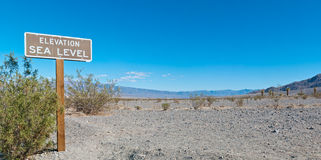 Sea level sign at desert Stock Image