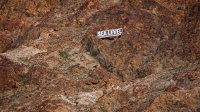 Sea Level Sign on Mountain Side in Death Valley Royalty Free Stock Images