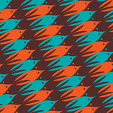 Sea life pattern with brown, orange and blue fishes. Marine tessellation background. Overflowing of one object to another. Vector illustration Stock Photos