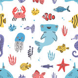Sea life seamless pattern. Hand drawn algae, blowfish, puffer, crab, hammerhead shark, whale, starfish, shark, seahorse. Sea life seamless pattern. Hand drawn Stock Photography