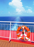 Sea and the lifebuoy. Travel on a yacht: a lifeline against the backdrop of the Atlantic ocean and the bright blue sky stock image
