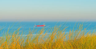 Sea in the light of sunrise in summer Stock Image