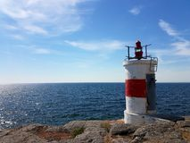By the sea. Lighthouse by the coast Stock Images
