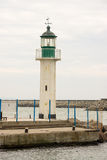 Sea lighthouse at the entrance to the water area of the port of Burgas, Bulgaria Stock Image