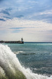 Sea lighthouse during the surf. On the Black Sea Stock Images