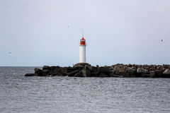 Sea lighthouse in ventspils, Latvia. Summer day Stock Images