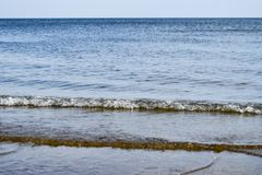 Sea line of the horizon. Sea and sky. The waves and glare of the Royalty Free Stock Photo
