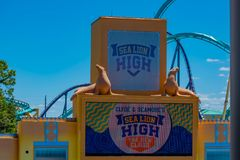 Sea Lion High The New Class show sign and Kraken rollercoaster on lightblue sky background at Seaworld. Orlando, Florida. April 20, 2019. Sea Lion High The New royalty free stock photos
