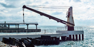 Sea loading crane. Construction in the sea Stock Images