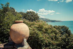 Sea. Lush vegetation and an ancient clay pot overlooking the sea Royalty Free Stock Image