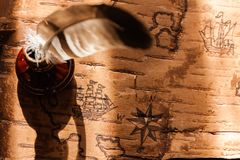 Sea map with illustrations of sailing vessels and compass rose. On the order of antiquities on birchbark stock images