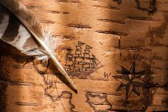 Sea map with illustrations of sailing vessels and compass rose. On the order of antiquities on birchbark royalty free stock photography