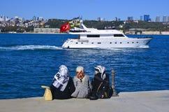 Sea of Marmara, the Bosphorus. Middle East three women sitting o. Istanbul, Turkey - October 20, 2013: Sea of Marmara, the Bosphorus. Middle East three women Stock Image