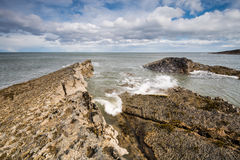 Sea meets rocks at Howick Royalty Free Stock Photo