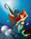 A sea with a mermaid near the wrecked boat. Illustration of a sea with a mermaid near the wrecked boat Royalty Free Stock Images