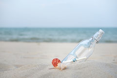 Sea-message. Bottle with a message on the desert beach by the sea with copy space to write Stock Photo