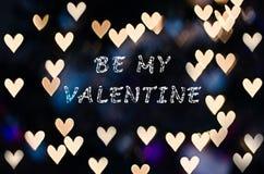 Sea mi tarjeta del día de San Valentín con el bokeh del corazón Imagen de archivo libre de regalías