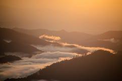Sea of mist. Around the mountains Stock Photos