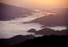 Sea of mist. Around the mountains Stock Photo