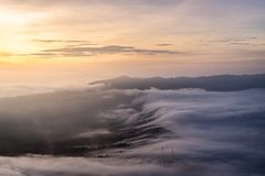 The sea of mist cover Cemero Lawang village during sunrise Royalty Free Stock Photography