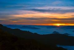 Sea mist. Sea fog on mountain with sunrise Stock Images