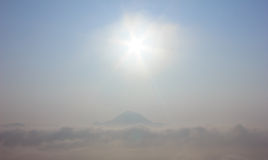 Sea Mist. Sunrise over mountain peaks with the sea mist Stock Photos