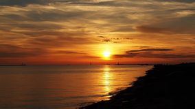 Orange red sunset and sea moll Stock Image