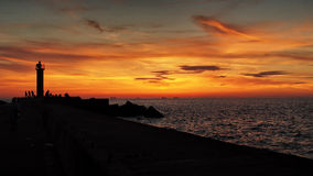 Orange sunset and sea moll  Stock Image