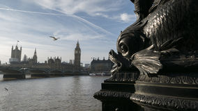 Sea monster eating Parliament. Sea monster architectural detail is threatening to eat the Houses Of Parliament in London stock photography