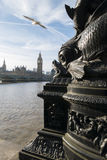 Sea monster eating Parliament. Sea monster architectural detail is threatening to eat the Houses Of Parliament in London royalty free stock photography